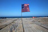 American Flag. American flags on the boardwalk on a beach. Laguna Beach California. Flags Waving for poster