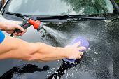Hands Hold Sponge For Washing Car.car Detailing Or Valeting Concept. Selective Focus. Car Detailing. poster