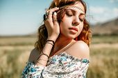 Portrait Of A Young Hippie Girl On A Wheat Field poster