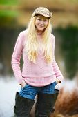image of fisherwomen  - beautiful girl with long blond hair and pink jersey fishing - JPG