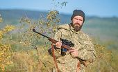 Hunting Is Brutal Masculine Hobby. Man Aiming Target Nature Background. Hunter Hold Rifle. Aiming Sk poster