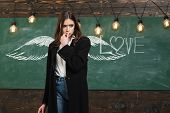 School Wings And Dream. School Lessons. Young Attractive Teacher Pointing At Chalkboard. Back To Sch poster
