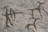 Old ancient petroglyph. Bronze age