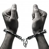 foto of sadomasochism  - closeup of the hands of a man with handcuffs on a white background - JPG