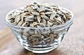 picture of sunflower-seeds  - Shelled sunflower seeds close up in glass bowl - JPG