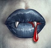 image of gothic female  - Horror Vampire bloody teeth and fangs with a gothic style female with black lips and human liquid blood dripping from the mouth against ghost like white skin as a demon concept and Halloween symbol of mystery and spooky fantasy - JPG