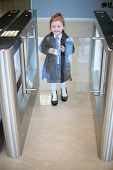 A little girl in a business clothes at the entrance to the business center