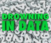 The words Drowning in Data on a sea of numbers illustrating an overabundance of numbers that are too