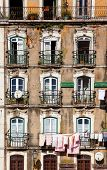 Lisbon, Portugal - February 01, 2013: Old and damaged 18th century neoclassical building in lower Al