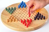 stock photo of chinese checkers  - chinese checkers and wood board - JPG