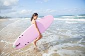 Young Girl With Surfboard