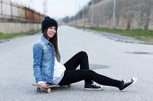 Young Fashionable Brunette Skateboarder Girl