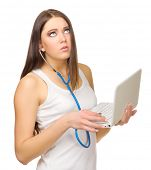 Young girl listen laptop by stethoscope isolated