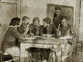 MOSCOW, USSR - CIRCA 1920s students-biologists conduct a scientific experiment.: An antique photo sh