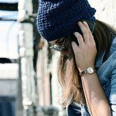 stock photo of depressed teen  - Teen girl calling smart phone outdoor - JPG