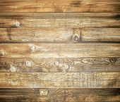 picture of log fence  - Background of brown old natural wood planks Dark aged empty rural room with tree floor pattern texture Closeup view to golden surface of retro pine logs inside vintage light warm interior with shadows - JPG