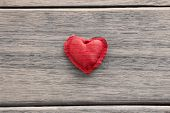 foto of wood craft  - Red heart handmade craft from silk cloth place in the middle of wood background valentine - JPG