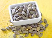 pic of fibrin  - pumpkin seed in bowl and on a table - JPG