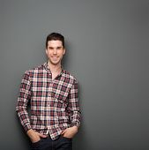 picture of charming  - Portrait of a charming young man in checkered shirt smiling - JPG