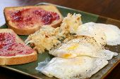 pic of hash  - Bacon and over easy eggs with hash browns for breakfast - JPG