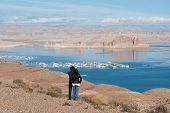 stock photo of southwest  - Couple overlooking Lake Powell and marina - JPG