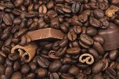 picture of cinnamon sticks  - close up of piled coffee beans cinnamon sticks and chocolate - JPG