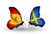 foto of spanish money  - Two butterflies with flags on wings as symbol of relations Spain and Sweden - JPG
