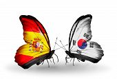 image of spanish money  - Two butterflies with flags on wings as symbol of relations Spain and South Korea - JPG