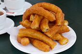 stock photo of churros  - a white plate of churros - JPG