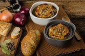 stock photo of french pastry  - It is the French onion soup with baked toast with cheese on top rustic pastry - JPG
