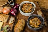 pic of french pastry  - It is the French onion soup with baked toast with cheese on top rustic pastry - JPG
