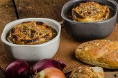 image of french pastry  - It is the French onion soup with baked toast with cheese on top rustic pastry - JPG
