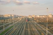 picture of red siding  - Railway tracks and one red train near Turin  - JPG