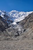 pic of shan  - Scenic Engilchek glacier with picturesque Tian Shan mountain range in Kyrgyzstan - JPG