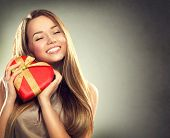 foto of ribbon bow  - Beauty happy girl with Valentine Gift box - JPG