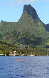 image of french polynesia  - tropical bay with a red navigation mark - JPG