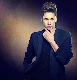 pic of macho man  - Fashion young model man portrait - JPG