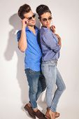 picture of she-male  - Side view of a casual couple posing near a grey wall - JPG