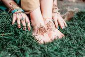 stock photo of hindu  - Indian hindu bride with mehendi heena on feet - JPG