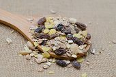 foto of sackcloth  - Oat flakes in wooden spoon on sackcloth background - JPG