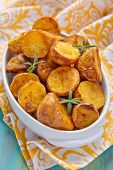 pic of baked potato  - Oven baked potatoes with rosemary in a baking dish - JPG