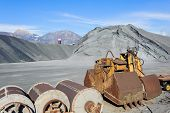 picture of ferrous metal  - Industrial Tools various and hill ferrous for metal foundry the background the Alps - JPG