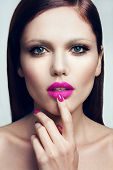 stock photo of pink eyes  - Portrait of beautiful girl with pink lips and blue eyes - JPG