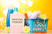 stock photo of detergent  - Detergent with washing powder and towels in basket isolated on white background - JPG