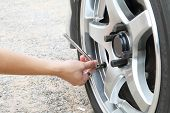 foto of air pressure gauge  - Check the tire pressure for safety drive - JPG
