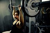 image of heavy  - strong bodybuilder teenager athlete with heavy weights in gym - JPG