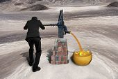 image of sand dollar  - Man drawing out golden sand with 3D currency symbols from retro water pump on the desert background - JPG