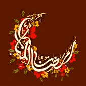 foto of ramadan mubarak  - Arabic Islamic calligraphy of text Ramadan Mubarak in moon shape decorated with colorful flowers on brown background - JPG