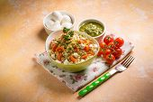 stock photo of pesto sauce  - vegetarian couscous with mozzarella tomatoes and pesto sauce - JPG