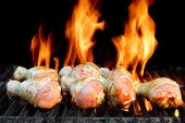 stock photo of bbq party  - Marinated Chicken Legs On The Hot BBQ Charcoal Grill - JPG